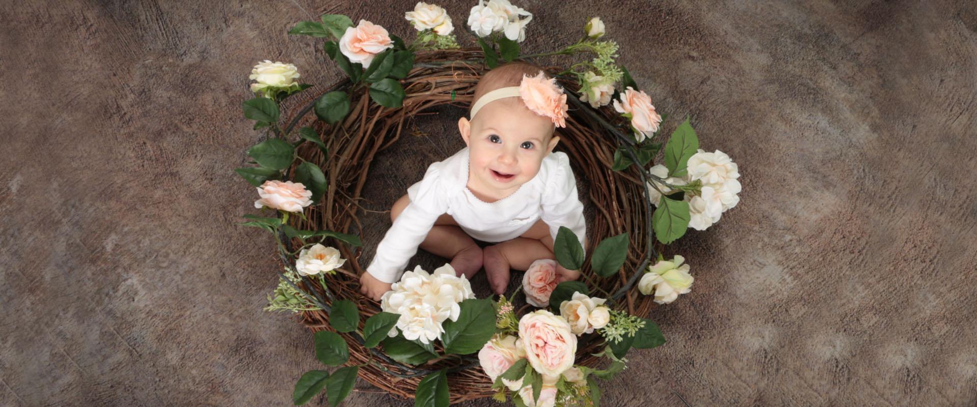 Baby girl Spring portrait with flower garland